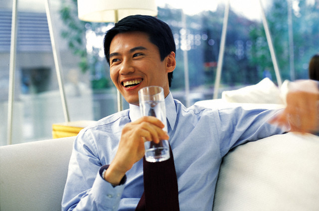 Cheerful Businessman Drinking Glass of Water