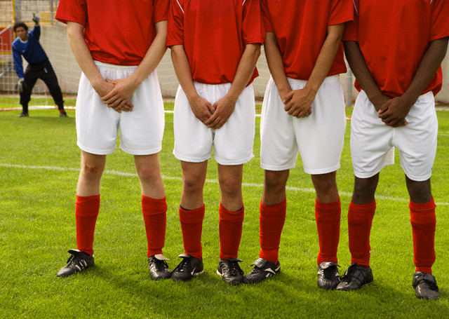 Soccer Players Lined Up to Defend Goal During Free Kick