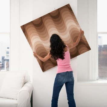 Woman Hanging Up a Painting