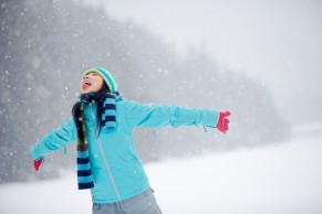 Woman Catching Snowflakes on Tongue