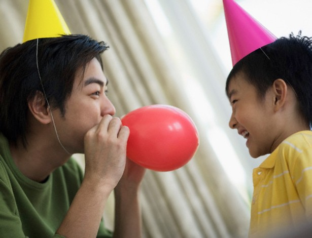 Father Blowing Up Party Balloon