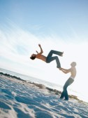 Two young men, one doing a back flip