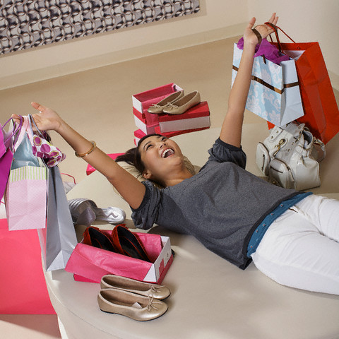 Happy woman happy surrounded by new shoes