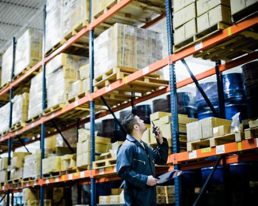 Warehouse Worker Talking on Walkie-Talkie