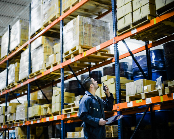 Warehouse Worker Talking on Walkie-Talkie