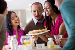 People Admiring a Dish at a Party
