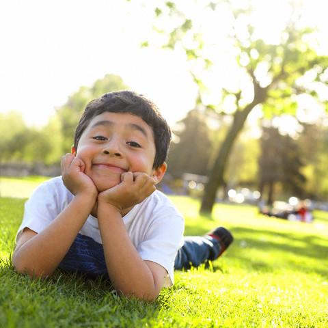 Boy reclining in grass