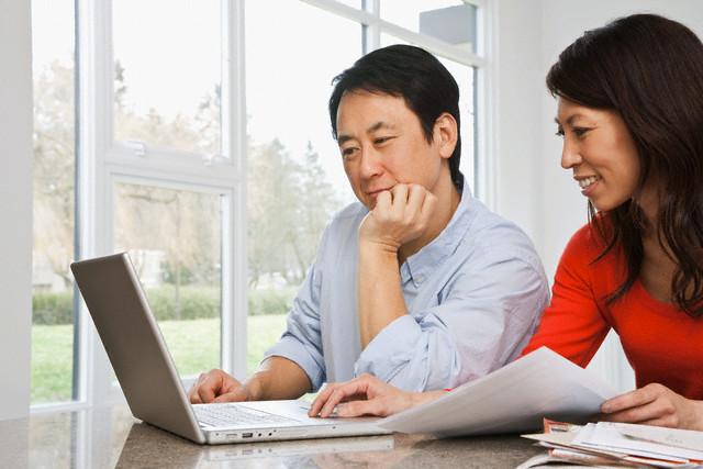 Couple using laptop to do finances