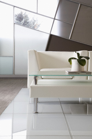 Modern armchair and coffee table in office waiting area