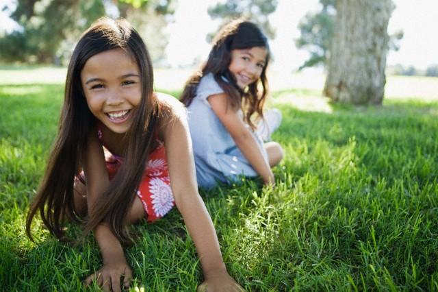 Girls sitting in park