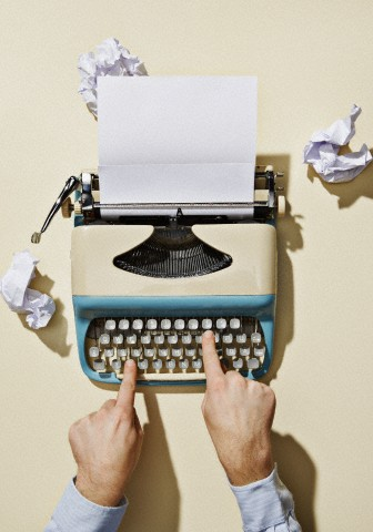 Person using typewriter