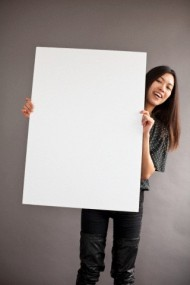 Woman holding blank white board