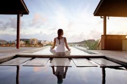 Young woman doing yoga on patio