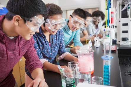 Students (13-15) in chemistry class