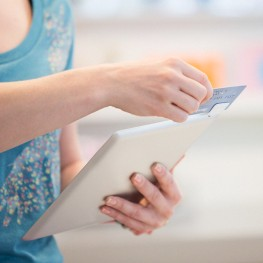 Young woman shopping and using tablet pc for payment