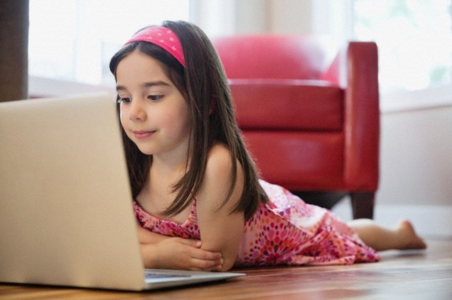 Little girl using laptop.