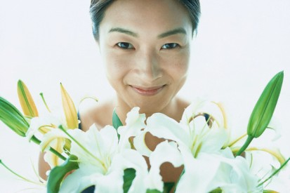 Smiling Woman Holding Lilies
