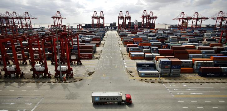 A container truck drives past the container area at the Yangshan Deep Water Port, part of the newly announced Shanghai Free Trade Zone, south of Shanghai