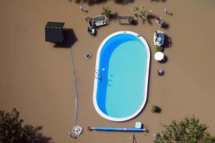 Garden with swimming pool is inundated by waters of Elbe river during floods near Magdeburg