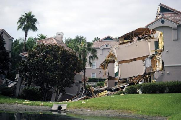 Section of the Summer Bay Resort lies collapsed after a large sinkhole opened on the property's grounds in Clermont, Florida