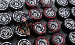 A Red Bull Formula One crew member prepares tyres at the pit ahead of the Singapore F1 Grand Prix