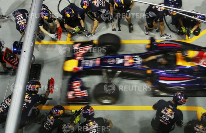 Red Bull pit crew practise changing tyres ahead of the Singapore F1 Grand Prix