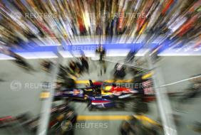 Red Bull pit crew demonstrate changing tyres ahead of the Singapore F1 Grand Prix