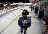 Red Bull team member waits in the pit lane during the second practice session of the Singapore F1 Grand Prix in Singapore