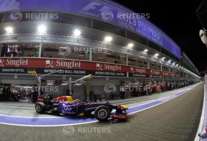 Red Bull Formula One driver Vettel drives out of his garage during the qualifying session of the Singapore Formula One Grand Prix