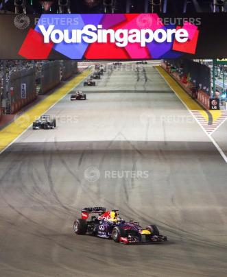 Red Bull Formula One driver Vettel drives ahead of the field on lap two of the Singapore F1 Grand Prix in Singapore