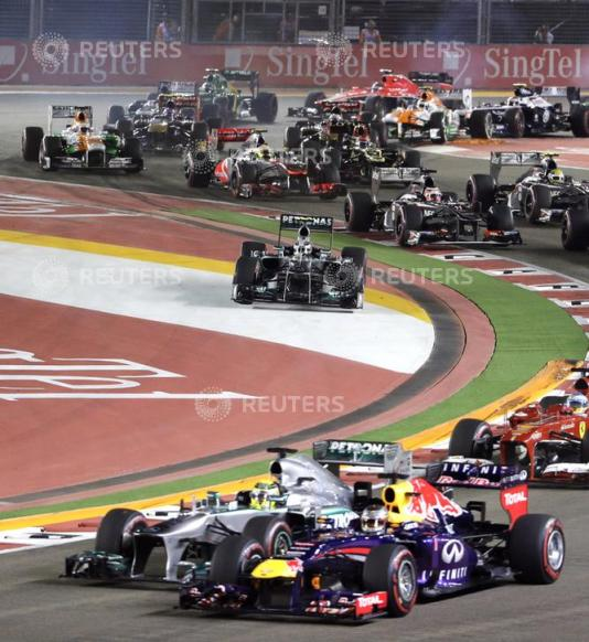Mercedes Formula One driver Hamilton runs wide on turn two of lap one during the Singapore F1 Grand Prix in Singapore