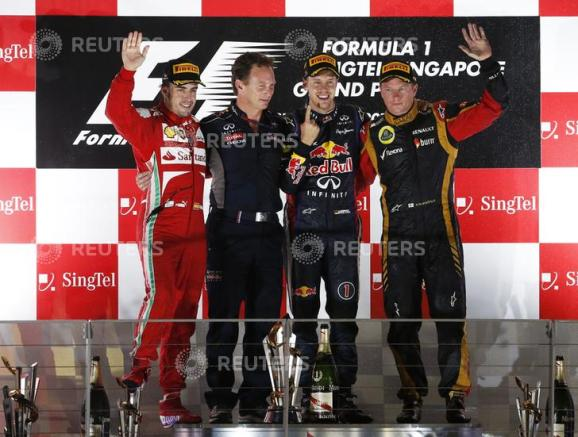 Ferrari driver Alonso, Red Bull team principal Horner, Red Bull driver Vettel and Lotus F1 driver Raikkonen stand on the podium after the Singapore F1 Grand Prix in Singapore