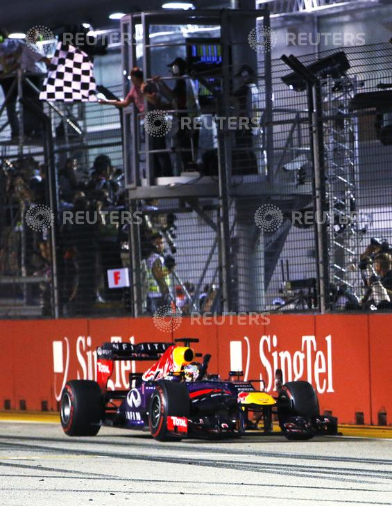 Red Bull Formula One driver Vettel takes the chequered flag to win the Singapore F1 Grand Prix in Singapore