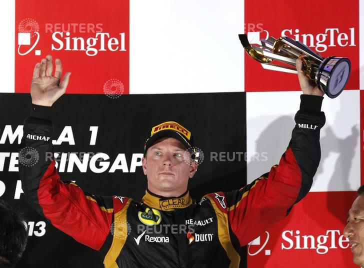 Lotus F1 Formula One driver Raikkonen celebrates on the podium after the Singapore F1 Grand Prix in Singapore