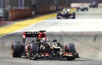 Lotus F1 Formula One driver Raikkonen races during the Singapore F1 Grand Prix in Singapore