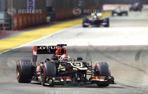 Lotus F1 Formula One driver Raikkonen races during the Singapore F1 Grand Prix in Singapore