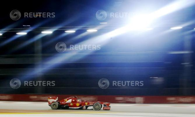 Ferrari Formula One driver Alonso races during the Singapore F1 Grand Prix in Singapore