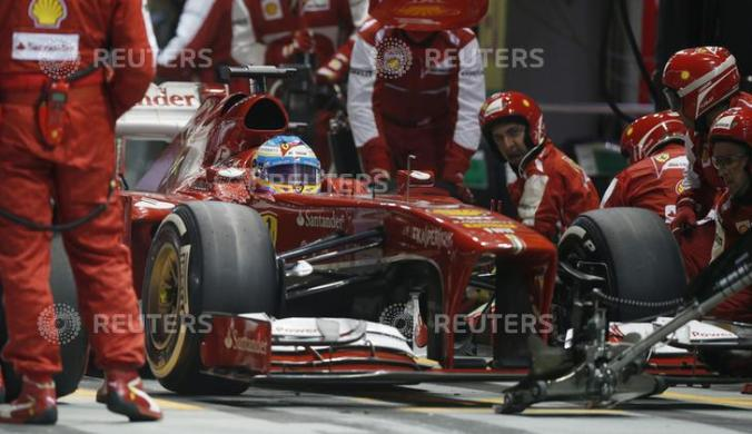 Ferrari Formula One driver Alonso performs a pit stop during the Singapore Grand Prix