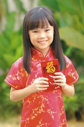 Girl Holding Red Packet During Chinese New Year