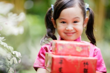 Young Girl Holding Gifts