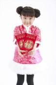 Smiling girl holding Hong Bao envelopes