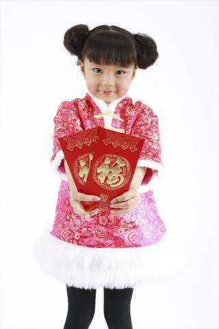 Smiling girl holding Hong Bao envelopes