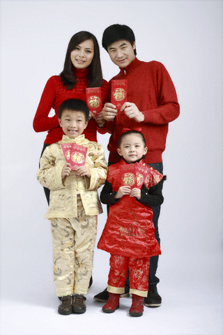Young family with New Years gift envelopes