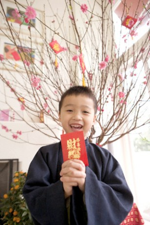 Boy holding a red envelope