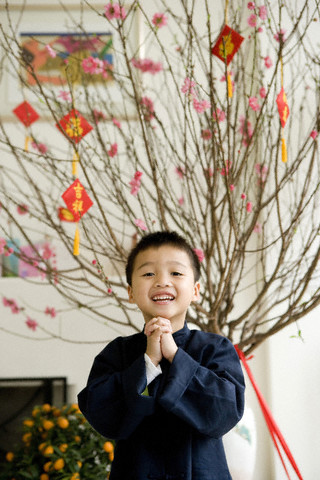 Portrait of a boy wishing