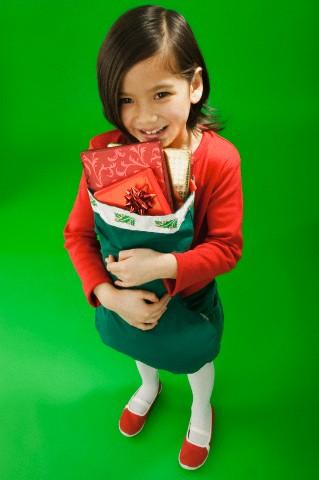 Little girl holding a Christmas stocking
