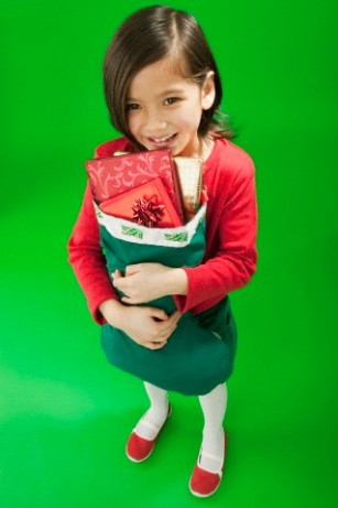 Little girl holding a Christmas stocking