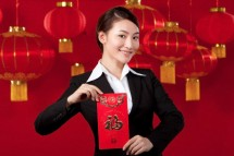 Businesswoman Holding Red Envelopes