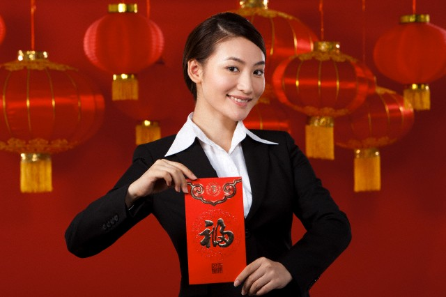 Businesswoman Holding Red Envelopes