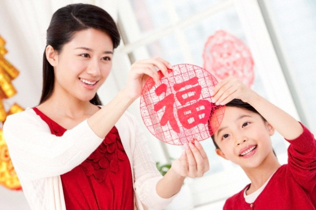 Mother and daughter with Chinese New Year paper-cut